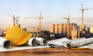 Concept of construction and design. 3d render of blueprints and designer tools on the panorama of construction site.
